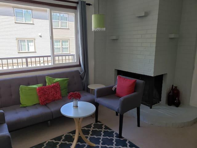 open living space, comfortable loveseat/futon