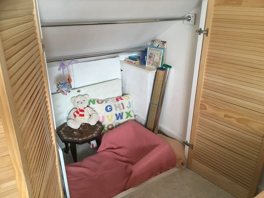 Den in the fitted cupboard