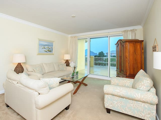 Enjoy views of the Gulf and the pool in the comfortable living room.