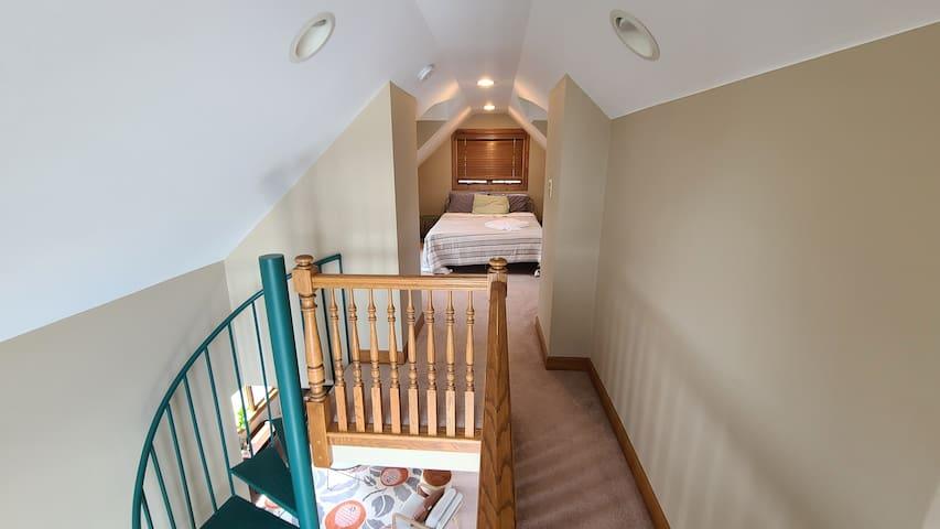 Bedroom 6 - 1 queen bed in loft above bedroom 5. Also includes reading nook (twin bed) overlooking lake