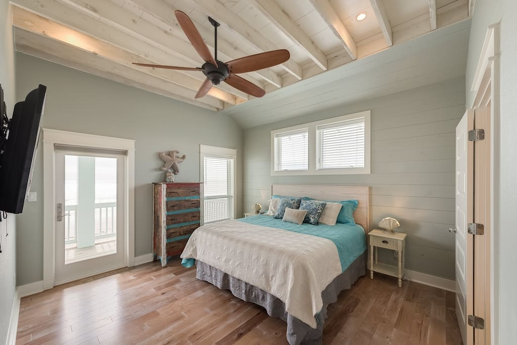 One of two master suites with king bed and private bathroom. This bedroom is on the second floor and has its own bathroom and access to a large 2nd floor balcony.