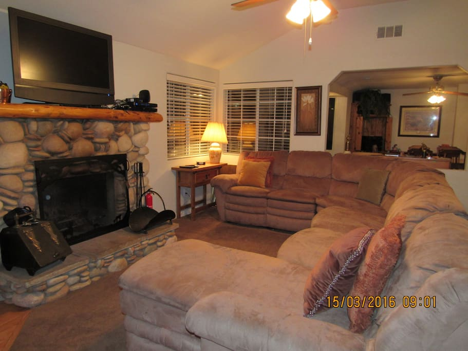 Living Room Couch, Fireplace & TV