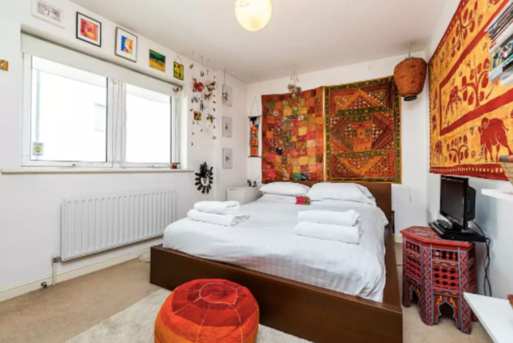 Bright and colourful private bedroom with blackout blinds for a good night's sleep.