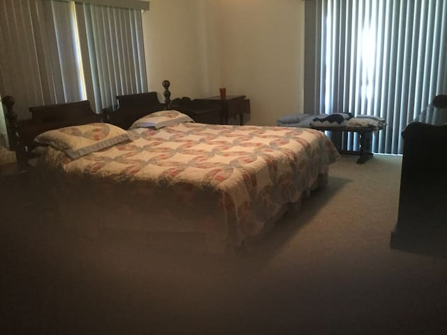 Large bedroom - king headboard - twin mattresses.