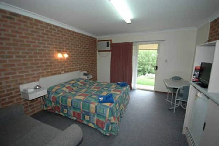 Modern motel room with licensed restaurant onsite