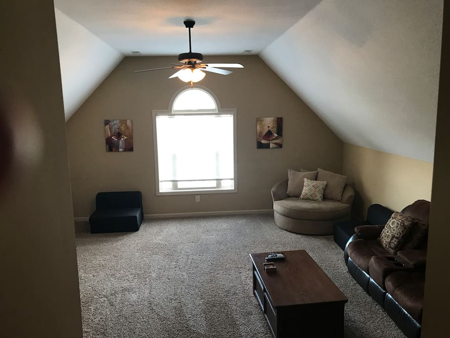 Large upstairs bonus room. Black chairs fold out to beds.