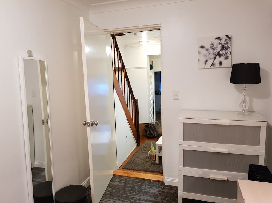 looking from the other corner: chest of drawers and entrance