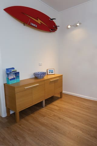 The sideboard contains extra serving ware, books catering from infants to adults, board and card games and binoculars (you'll appreciate them during whale migration - you get a fantastic view from the beach!)