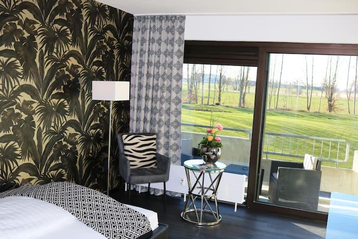 28m² Design Serviced Apartment im Grünen
