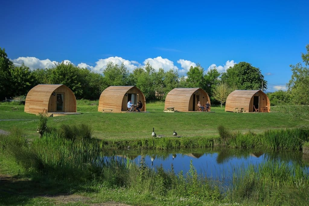 Our Glamping Pods overlook the picturesque fishing lake on site