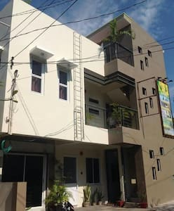 Cozy bedrooms n rooftop garden - Laoag City