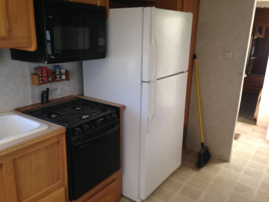 fill size refrigerator, Stove and microwave.