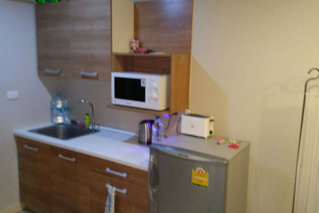 Kitchen with decent fridj microwave toaster blender cooking thermostat pot letter hairdryer. Shared just ask is glass oven iron etc
