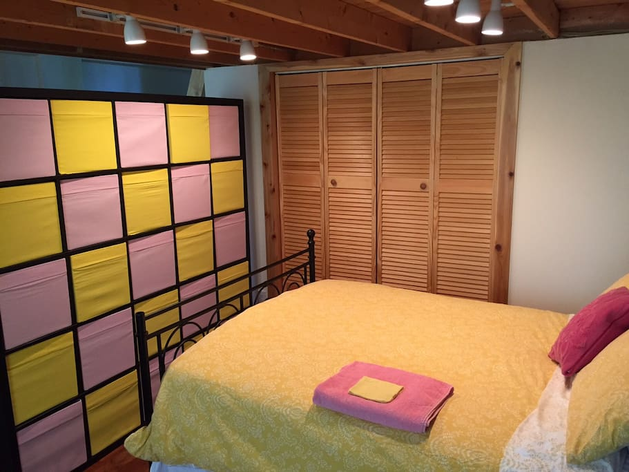 This is Full Size Bed you will be sleeping in.....hope you like our colorful wall that doubles as storage!