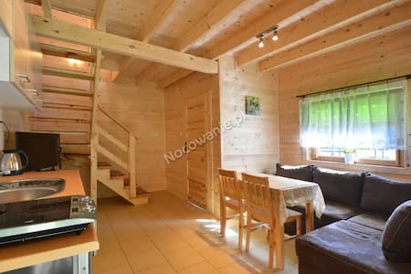 relaks w pachnacych drewnem domkach
