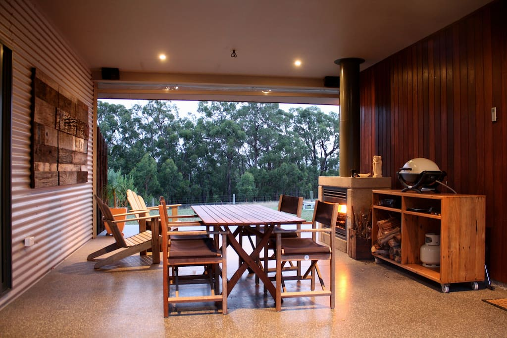 Undercover alfresco area with outdoor fireplace and BBQ.