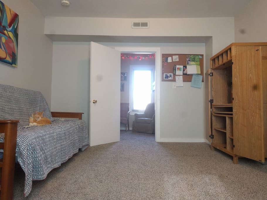 The room is spacious and comes with a large desk and high quality full size futon bed.