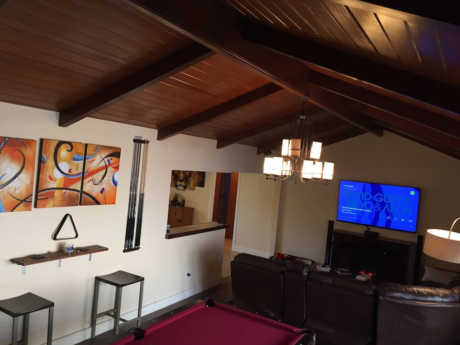 Pool Table, Dart Board, Side Bar, Shuffleboard, large TV with fireplace and massaging sectionals all for your entertainment
