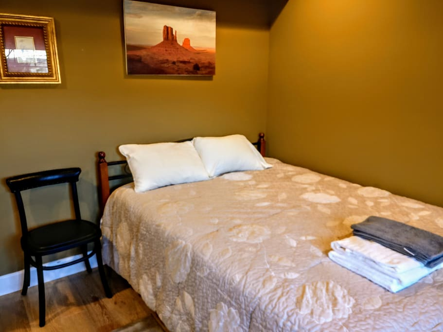 Queen sized bed with memory foam mattress. Wake up rested and relaxed.