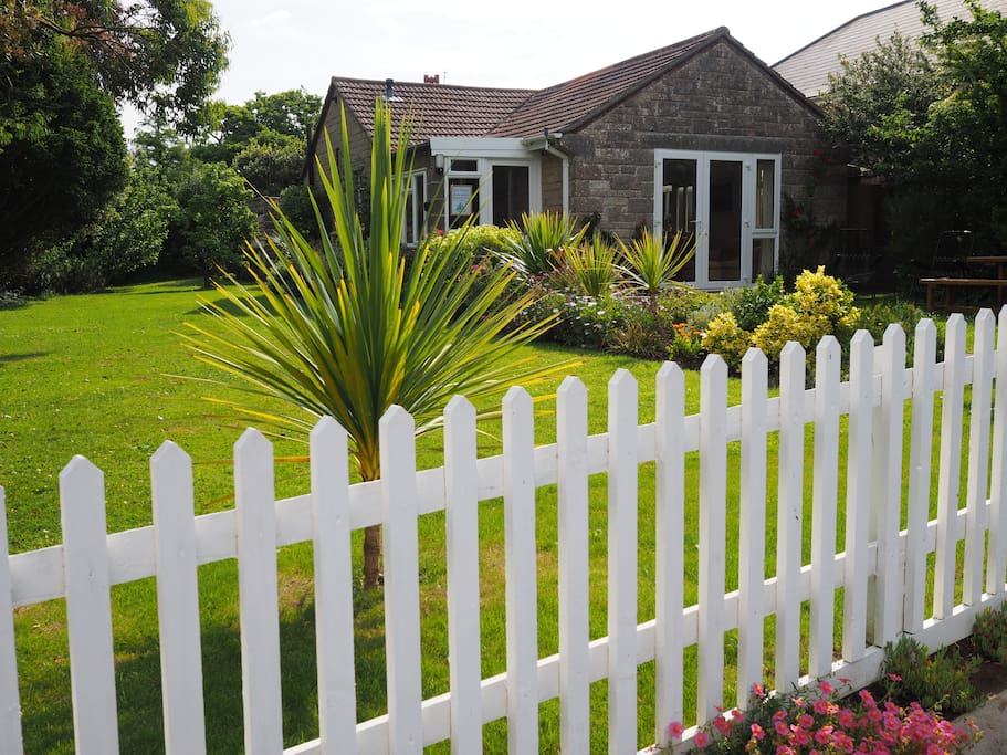 The garden at Cliffway with a wide expanse of level grass ideal for afternoon tea or to play.
