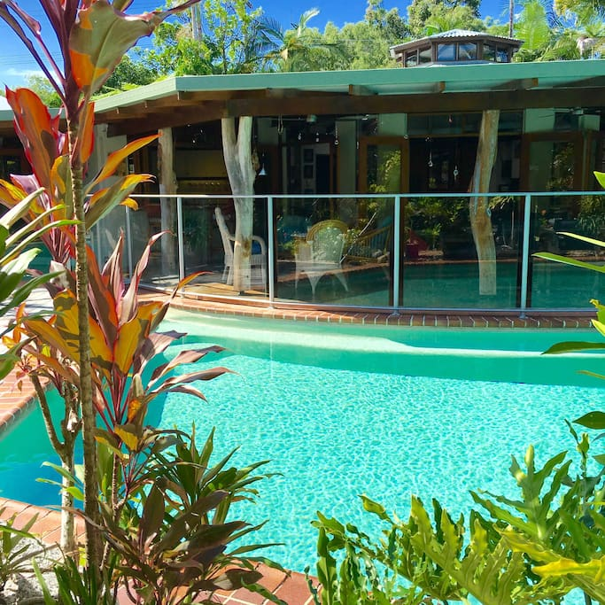 In the background is my Unique tropical octagonal shaped home with a huge skylight in the Center of the home. The large pool in front is great for a few laps and the large deck is a great entertainment area complete with barbecue.
