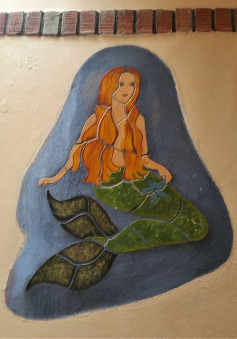 Mermaid mural in tile inside the entrance to Casa Serena