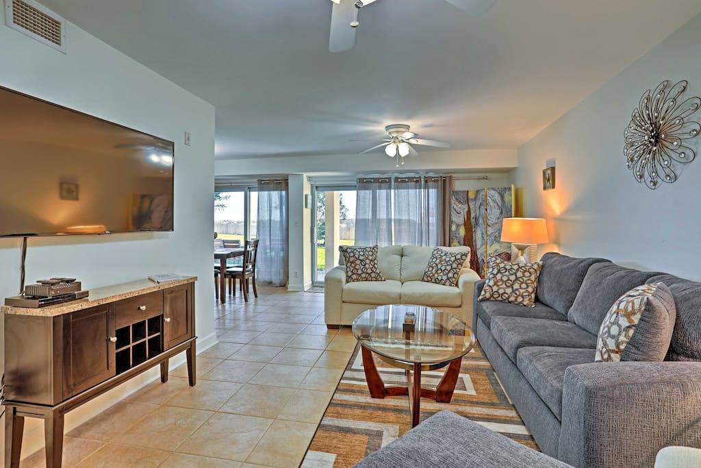 The first-floor condo is directly on the beach and features fabulous community amenities.