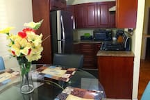Beautiful, Modern eat-in Kitchen,  fully equipped with all  Amenities