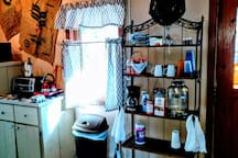 Stocked rack and kitchen area.