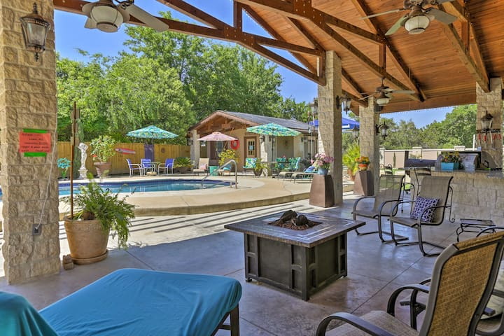 The backyard is a private oasis featuring a hot tub, pool, and games!