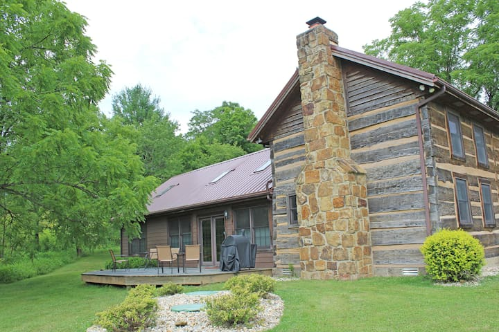 The Meadow Valley Cabin is an 1860's hand hewn log cabin completely renovated