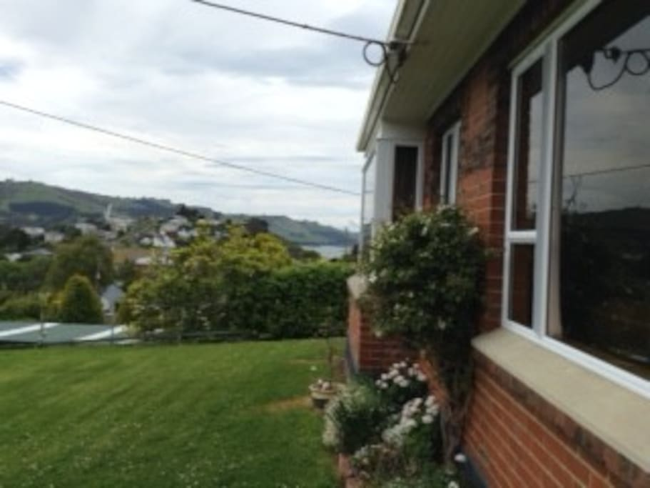 Front yard and entrance with views to the Otago Harbour.