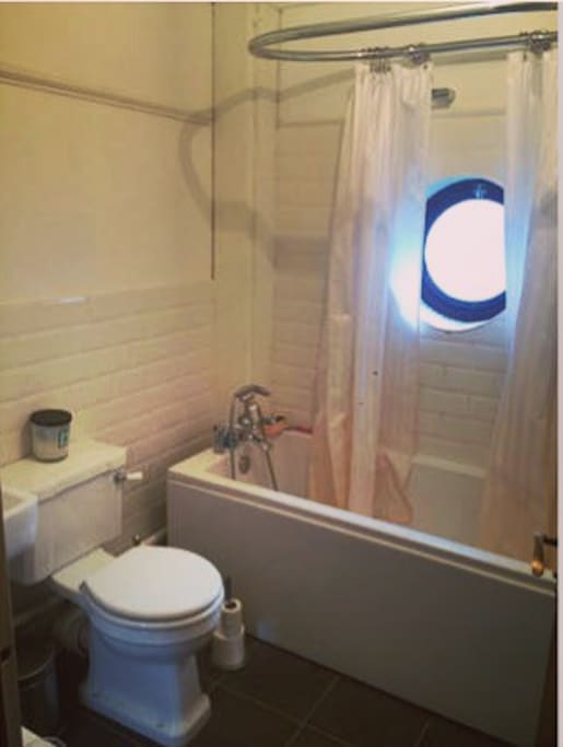 Bathroom - quirky nautical porthole window.