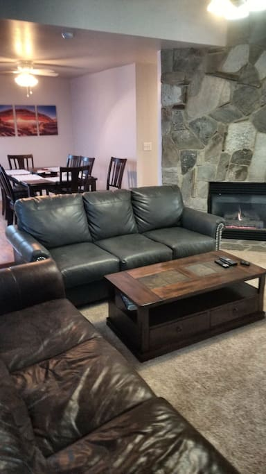 Living room. Fire Place Two leather couches. Smart Tv. with apps (Netflix, Hulu HBO Go)