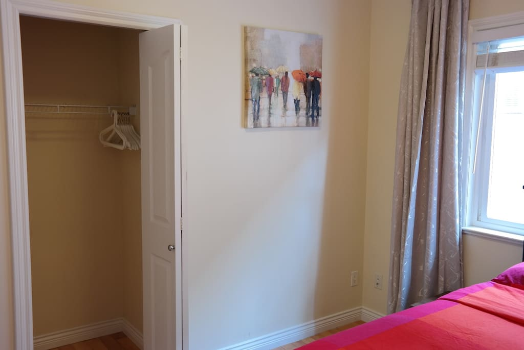 Large closet with ample space to store luggage and plenty of clothes hangers are provided.