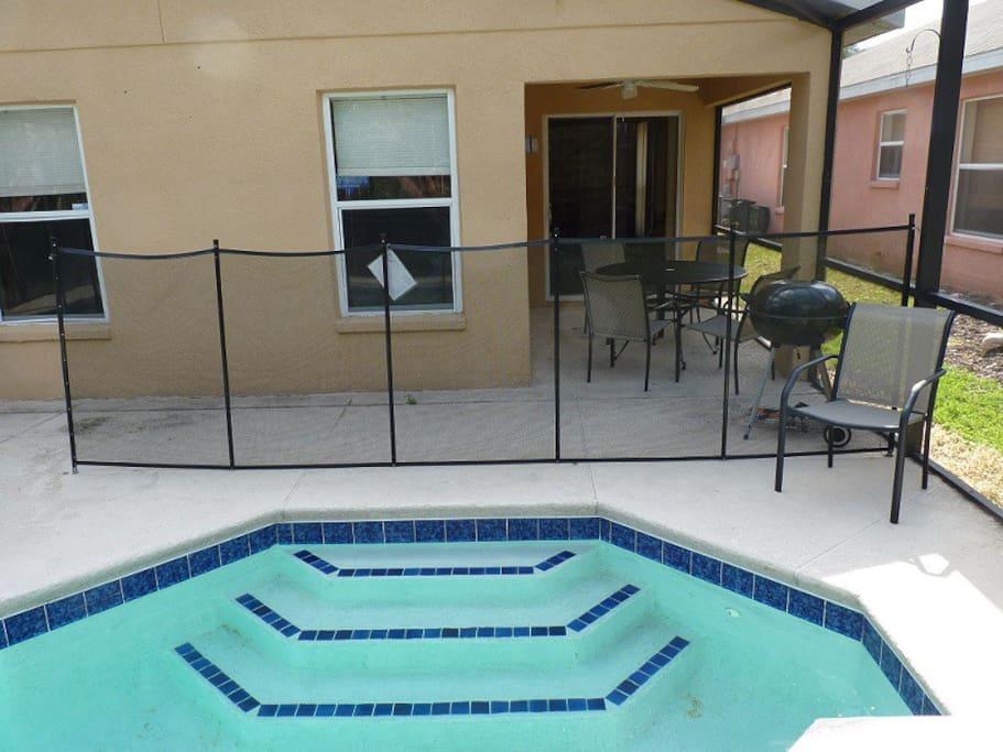 Fenced pool with optional pool heating.