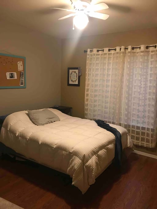 Private 1st floor bedroom w/ full bed, closet, & ceiling fan