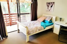 The king single bed is longer and wider than a standard single bed with a comfortable mattress.
