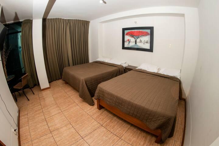 Doble camas dos plazas con Vista Lateral al Mar