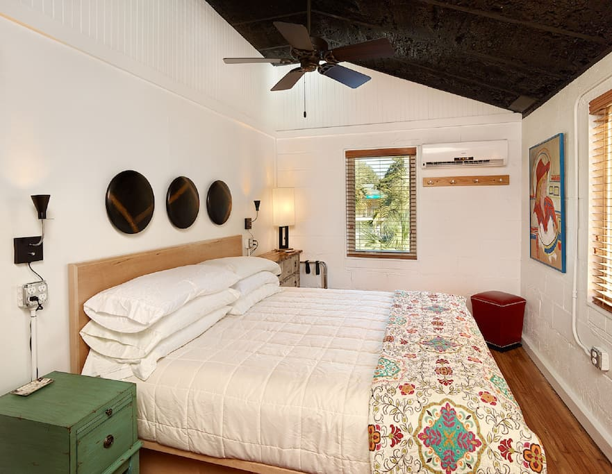 Master bedroom with comfy king size bed with upgrade linens, custom wardrobe, and a flat screen TV