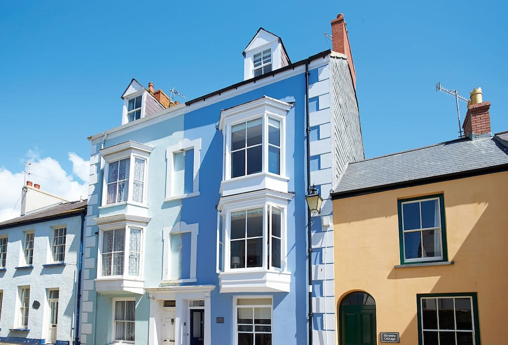 High House is the cornflower blue property with the dark front door
