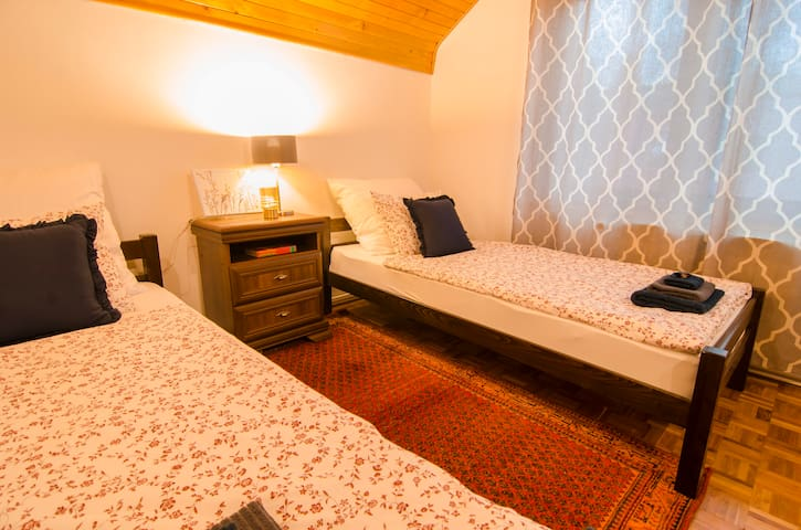 2nd bedroom has two single beds