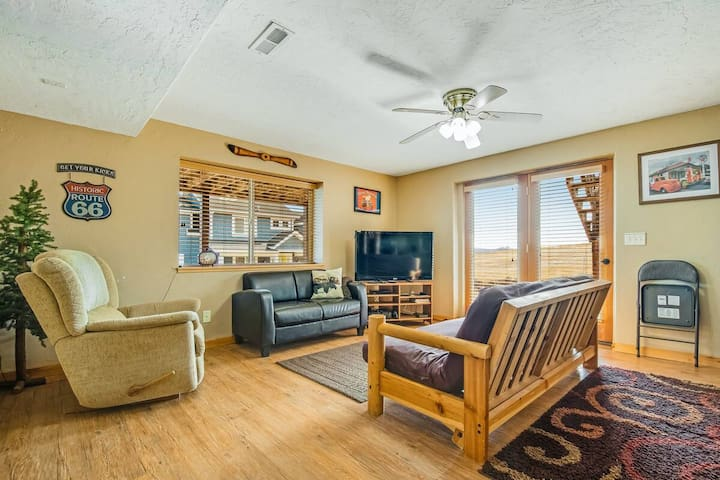 down stairs TV room with futon bed