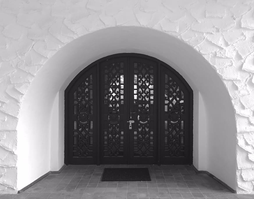 Intricately carved timber door welcomes guest