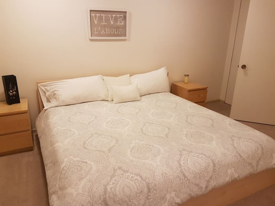 King size bed with high quality bedding.