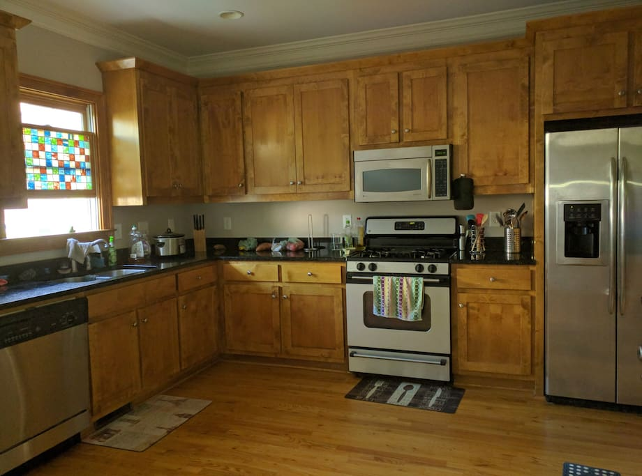 Large kitchen with gas stove.