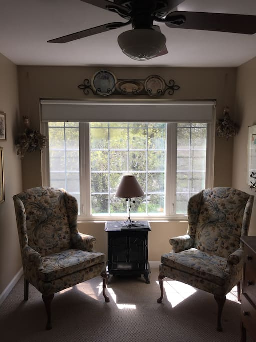 Enjoy a sunny spot to read or converse in this light, airy suite. If you choose, you can take your optional breakfast on the table aside this cozy sitting area.