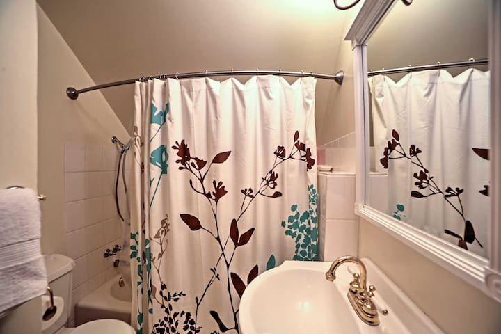 Freshen up for the day in the pristine bathroom.