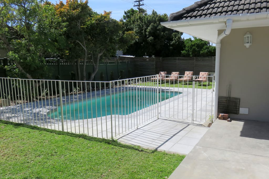 Pool area with loungers and heated pool (option to turn off)
