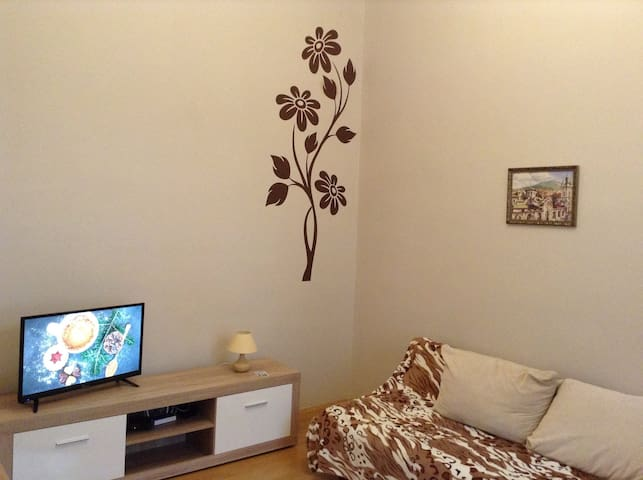 Foldable sofa bed to relax on, interesting wall flower decor